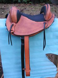 trail saddle leathers directly under rider