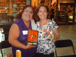 Kris and I holding my published books