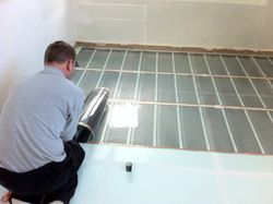 Doug J Tyler fitting Underfloor Heating