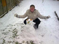 Esther building a snowman