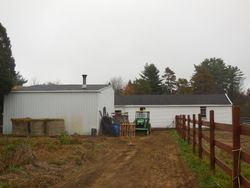 Looking from garden to tractor garage and barn