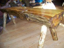 typical garden bench,1/2 log-poplar,strait round legs