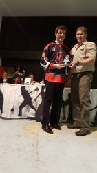Doug presents Most Sportsmanlike Team to MB captain Christian