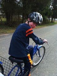 Jaxs and Sidnee taking a bike ride.