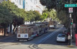 A line-up of Cable Cars on Beach Street.
