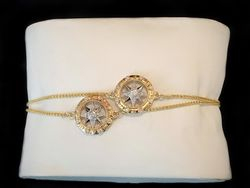Two bracelets, compass rose on chain in 14k