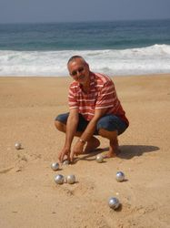Playing boules on the beach near the marina in Nazares