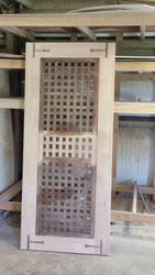 distressed sliding door using salvaged ship hatch covers
