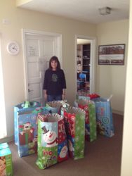 Susan with Christmas Gifts for Families