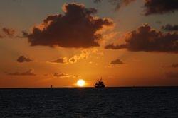 The Unicorn sailing past at sunset