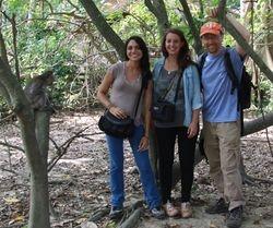 "1 Macaca fascicularis (""Who's this one, Nora?"") and 3 Homo sapiens: Silvana Sita, Elenora Neugebauer, and JB Leca (Ubud, Bali, June 2016)"