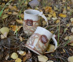 Mugs with Leaf Stamped Buttons