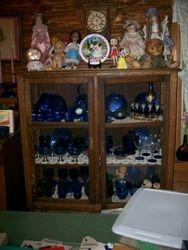 antique oak display china cabinet, vintagecolbolt blue depression glass, antique dolls, antique clocks