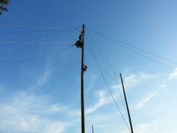Catherine Norris climbs to zip line platform