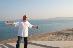 Mike Villani in Doha, Qatar with Saudi Arabia in the background
