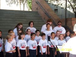 Camp helpers join in to sing