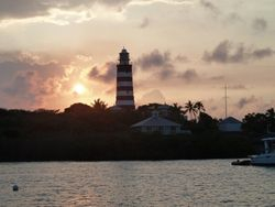 Sun setting behind the Hope Town lighthouse
