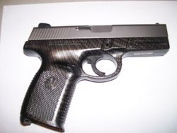 S&W 9mm Processed in Carbon Fiber  Flat Cl