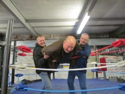 Paul Parissio and Len 'Hurricane Smith tip Harry Monk over top rope