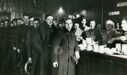Troops lining up for a cuppa at Bovington YMCA hut in Lincolnshire
