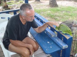 John with Charlie, the Dive Bequia parrot