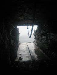 Down the passage of the Tomb of the Eagles