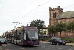 Flexity 014 passing St. Peter's Church