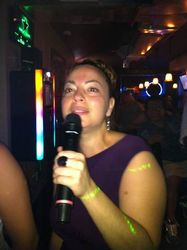 "Madeline doing her version of ""Como la Flor"" at 502 Bar Lounge's Social Saturday Night Karaoke!"