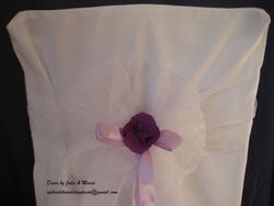 White bow with flower and ribbon.