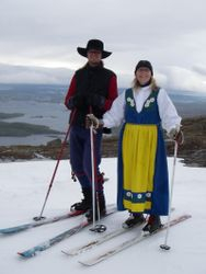 Me and Bob, telemarking in folkdresses.