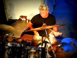 Greg Wilson on drums