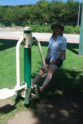 Ann trying out the exercise equipment in the park