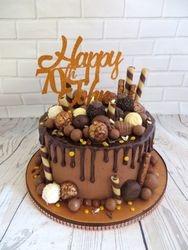 70th birthday bronze drip cake