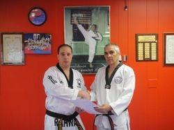 Grand Master Solomon Pavlou giving Master Felix Nodarse an  Award