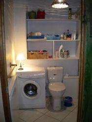 Sdb avec baignoire et machine à laver