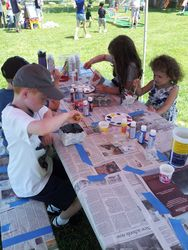 The kids hard at work, painting rocks