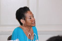 Cawanda listens closely to Dr. Harris
