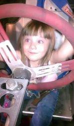 Haley test driving Grandpa's car. :)
