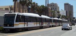 A train of P2000 LRVs on Long Beach Boulevard.