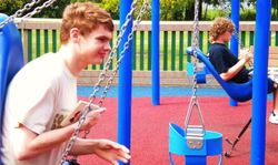 Brothers on the swings