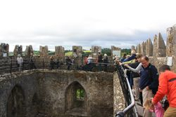 Lining up to kiss the Blarney Stone at Blarney Castle