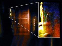 Hand in the doorway