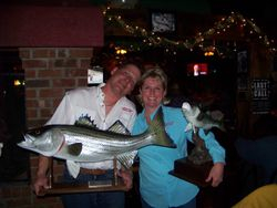 """David Nova and Edie Jett and their """"Angler of the Year"""" trophies"""