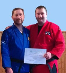 Presentation of Certificate in Healing Arts - First Level to Sensei Alan Mitchell by Sensei Brian Mearns