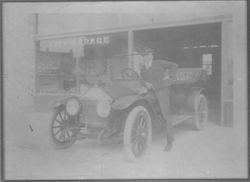 Claude Manning in front of City Garage 1920's