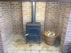 M/f stove fitted in old brick recess