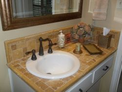 Travertine tile counter top with porcelin sink