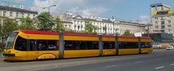 Side view of a PESA 122N on Marszalkowska