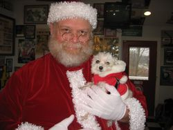 Santa-Paul w/ his tiniest helper.