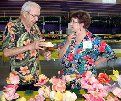 Bobby and Liz Williams go over his blooms.
